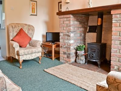 Spend a snug evening in front of the wood burning stove at Brambles