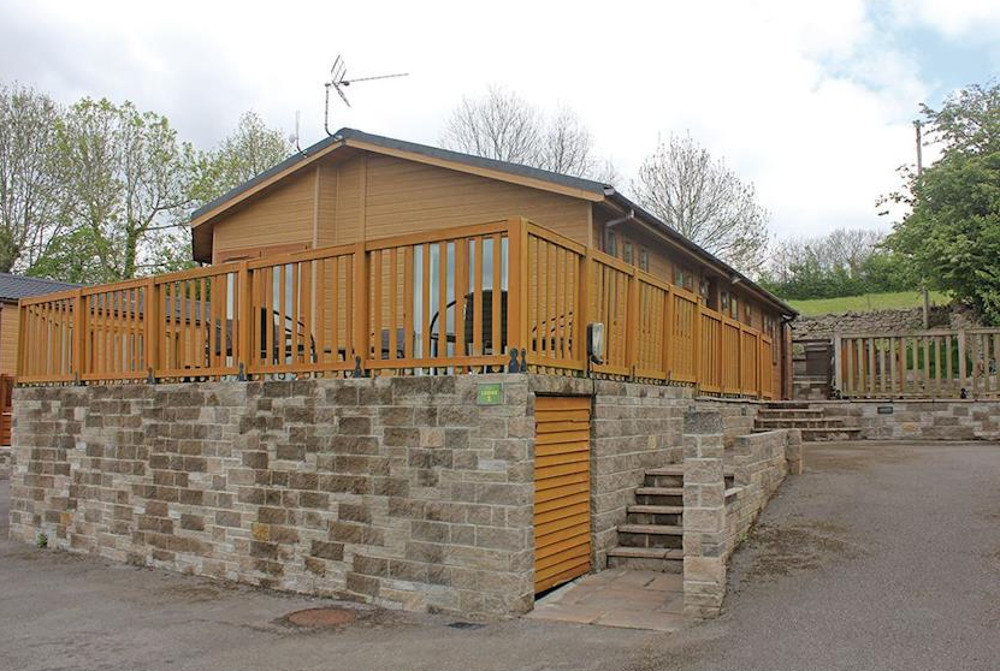 One of the lodges at Bucklegrove Holiday Park in Somerset