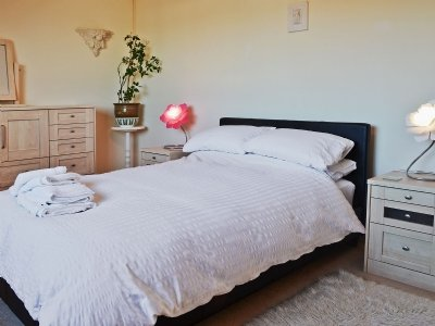 One of the bedrooms at Cabasson in Benllech