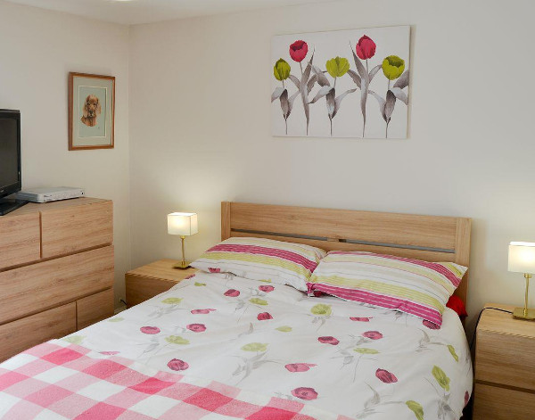 One of the two bedrooms at Courtyard Cottage in Framlingham