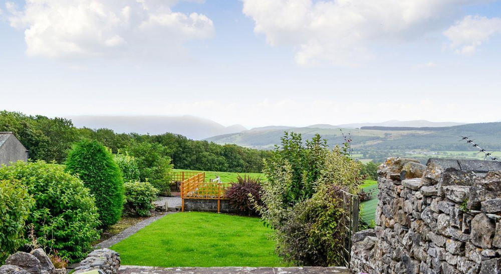 The garden with rural views at Croft House Barn near Cockermouth