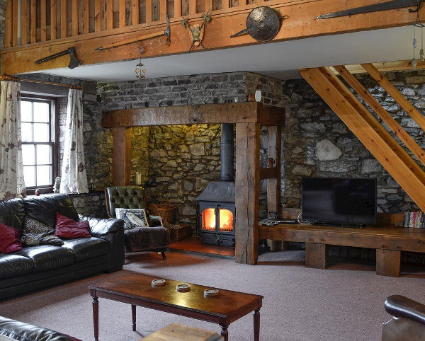 The living room with a wood burning stove at Croft House Barn in Blindcrake