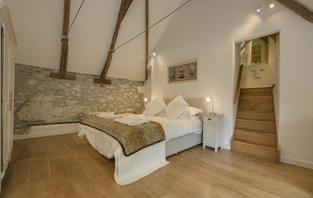 The beamed bedroom at Cullaford Cottage in Devon