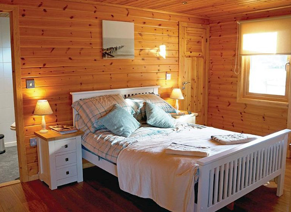 Fairway Lakes Lodges at Caldecott Hall Golf and Spa are Scandinavian lodges with a hot tub