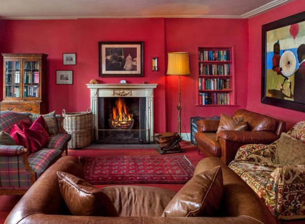 The living room with an open fire at Old Vicarage, Crickhowell