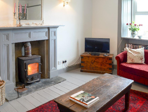 The living room and wood burning stove at Seafield House in Lochinver
