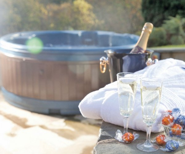 Relax in the hot tub at Slate House Lodges in Llandinam