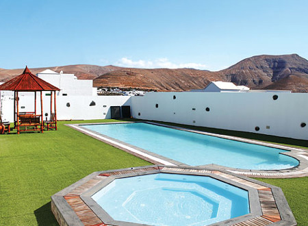 The swimming pool, garden and views at Villa Temi on Lanzarote