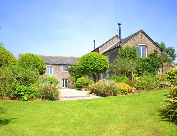 Wild Goose Barn & The Creamery is a large holiday cottage in Kingston, Devon. Wild Goose Barn & The Creamery sleeps 12 people